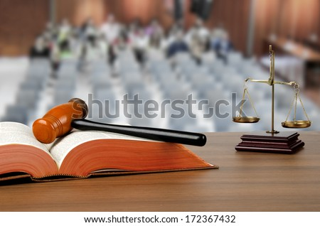 Mallet, legal code and scales of justice in court - stock photo