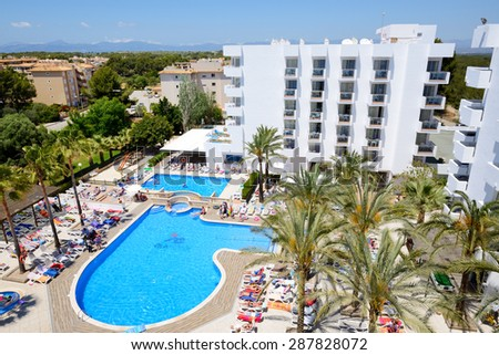 MALLORCA, SPAIN - MAY 28: The tourists enjoiying their vacation in luxury hotel on May 28, 2015 in Mallorca, Spain. Up to 60 million tourists is expected to visit Spain in year 2015. - stock photo