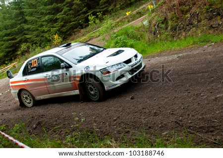 MALLOW, IRELAND - MAY 19: G. Lucey driving Mitsubishi Evo at the Jim Walsh Cork Forest Rally on May 19, 2012 in Mallow, Ireland. 4th round of the Valvoline National Forest Rally Championship.
