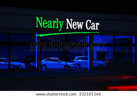MALMEDY, BELGIUM - JULY 28: Neon signs at the showroom of a used cars seller, European demand for used cars is rising and car sales for new vehicels are decreasing on July 28, 2014 in Malmedy Belgium - stock photo