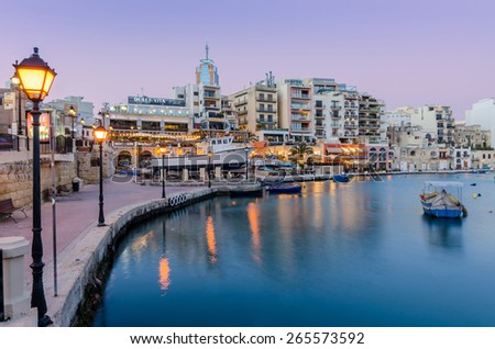MALTA, SAINT JULIAN'S - March 29 2015: Sunset on Saint Julian's. Saint Julian's is Malta's top tourist destination full of restaurants, entertainment and nightlife - stock photo