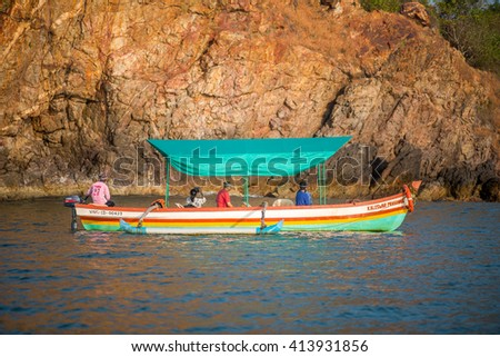 MALVAN, INDIA - November 12, 2015: Traditional wooden tourist boat at Nivti beach, Nivati, Malvan, Konkan, Maharashtra, India, Southeast Asia.