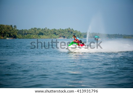 MALVAN, INDIA - November 12, 2015: Young boy tourist enjoy speed boat ride water sport at Devbag beach, Tsunami Island, Tarkarli, Malvan, Konkan, Maharashtra, India, Southeast Asia.