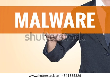 Malware word Business man touch on virtual screen orange background - stock photo