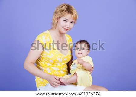 Mama embraces his cute daughter family happy - stock photo