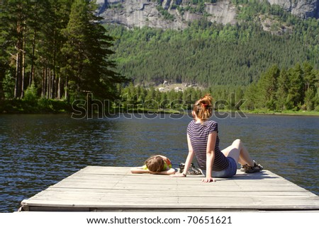 mama with daughter sitting on the berth - stock photo