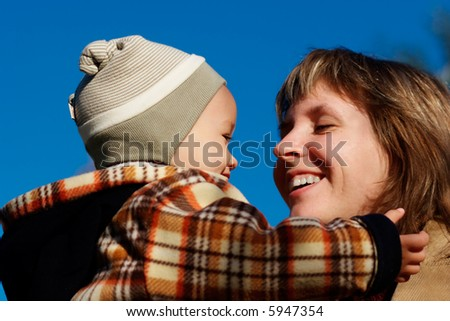 Mama with her son together - stock photo