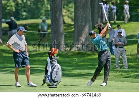 MAMARONECK, NY - JUNE 13: Tiger Woods hits an approach shot as he prepares to play, but missed the cut, in the 2006 US Open at Winged Foot on June 13, 2006 in Mamaroneck, NY. - stock photo