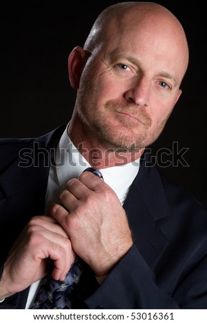 Man Adjusting Tie - stock photo