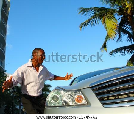 Man admiring his new ride - stock photo
