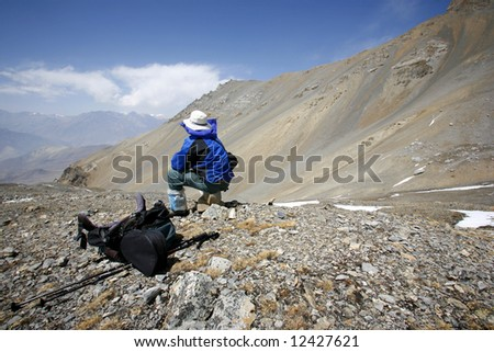 man admiring view in the himalayas, annapurna, nepal