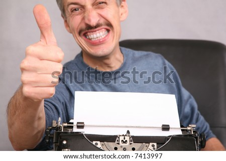 man after the typewriter shows gesture by the finger