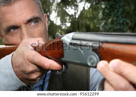 Man aiming a rifle - stock photo