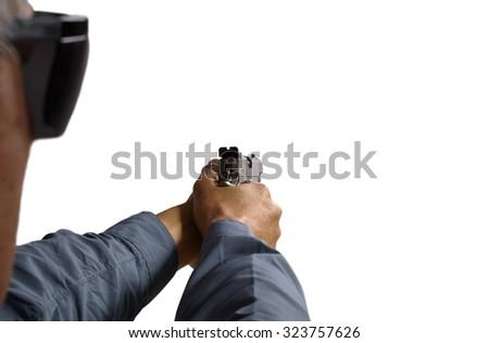 Man Aiming and Shooting Semi Automatic 45 Handgun - stock photo