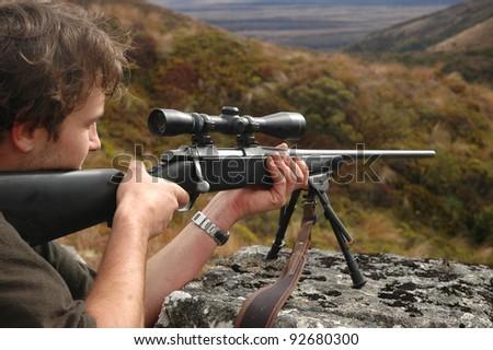 man aiming rifle - stock photo