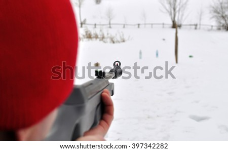 man aims with rifle - stock photo
