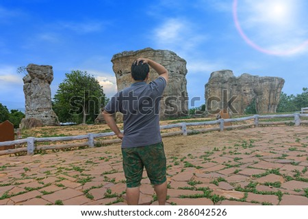 Man amazing see big stone emerged on top the mountain  - stock photo