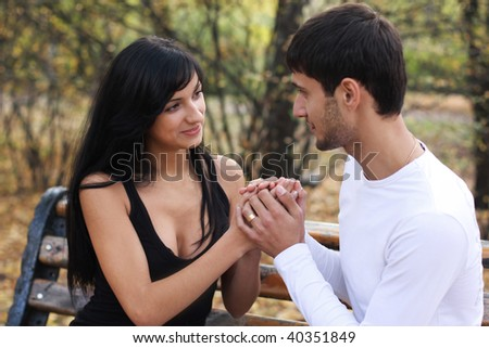 man and a woman on the blurred background - stock photo