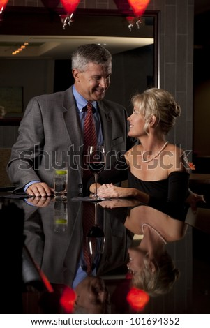 Man and a Woman Together in a Bar - stock photo