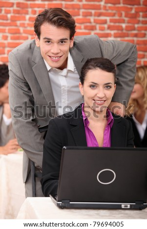 Man and a woman using a laptop computer