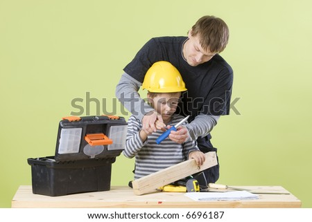 Man and boy Building - stock photo