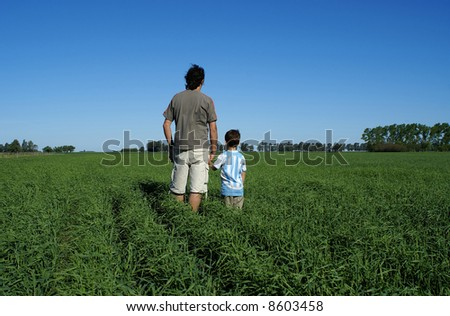 Man and boy looking at the nice wheat field