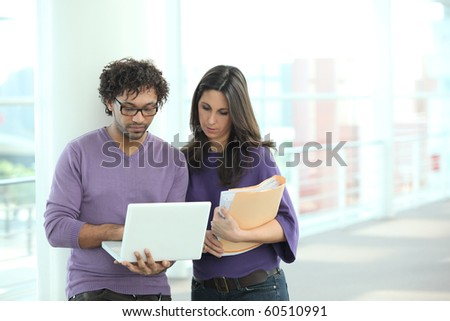 Man and businesswoman  in the lobby of the company - stock photo