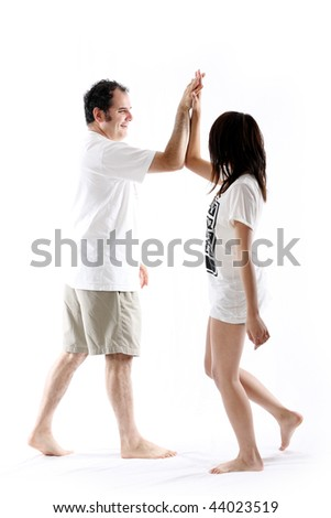 man and girl, high fiving each other against white - stock photo