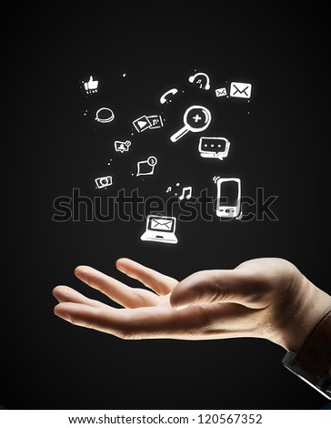 man and icons symbol over hand - stock photo