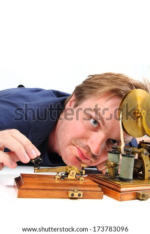 man and old telegraph - stock photo