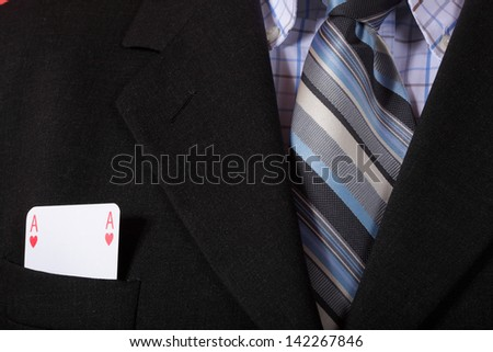 man and playing cards in pocket