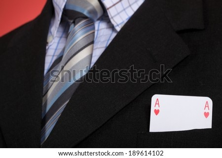 man and playing cards in pocket - stock photo