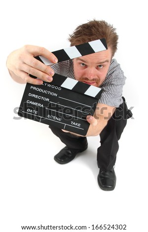 man and the clapboard - stock photo