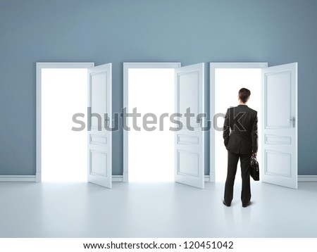 man and three opened doors - stock photo