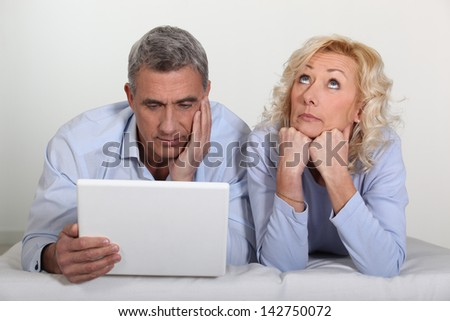 Man and wife bored - stock photo