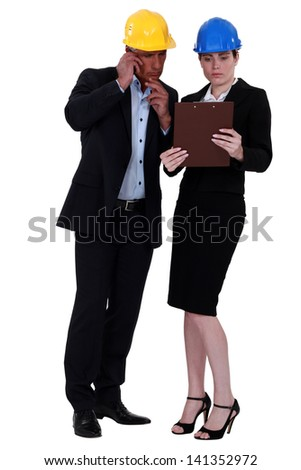 Man and woman architects - stock photo