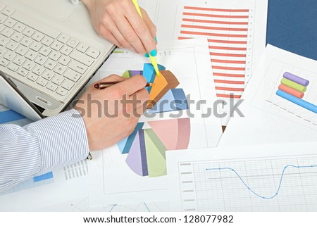 man and woman are working with graphs - stock photo