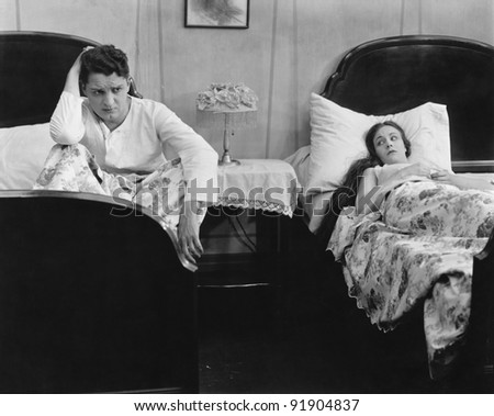Man and Woman arguing in bed