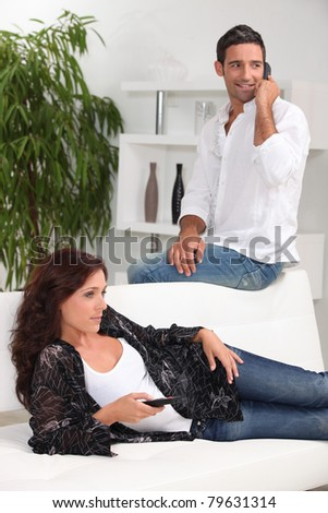 Man and woman at home - stock photo
