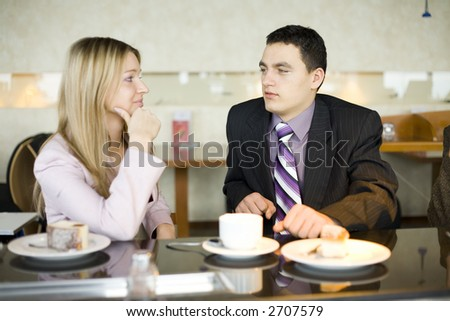 Man and Woman at the Bar. Short Depth of Focus (On Man's Face). - stock photo