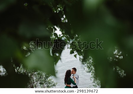 man and woman at the lake to spend time in each other's arms