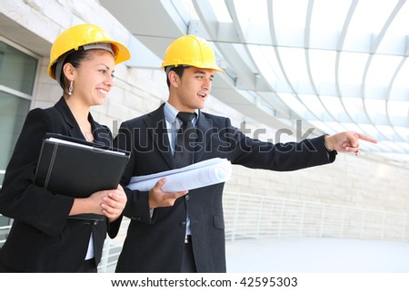 Man and woman business team working construction on the building site - stock photo