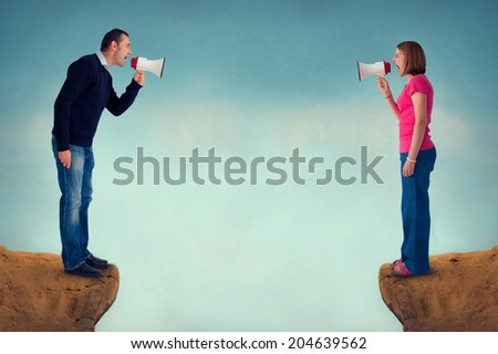 man and woman conflict concept with bullhorn and crevasse - stock photo