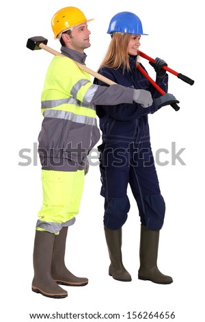 Man and woman construction workers - stock photo