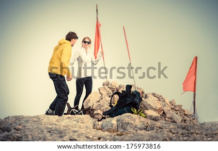 Man and Woman couple Travelers on Mountain summit with backpack Traveling Mountaineering concept fog on background - stock photo