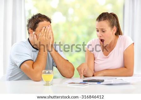 Man and woman desperate over financial crisis at their home - stock photo