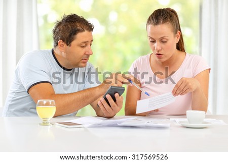 Man and woman discussing home economics - stock photo