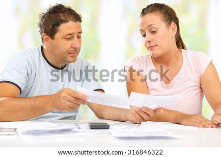 Man and woman discussing their home economy