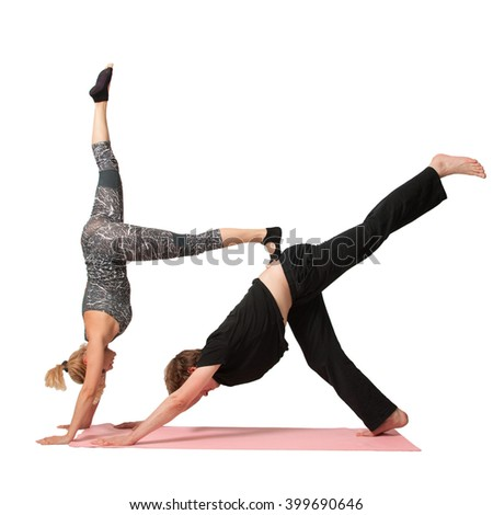 Man and woman doing acro yoga or yoga with partner on a white background