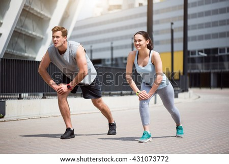 Man and woman doing some exercising